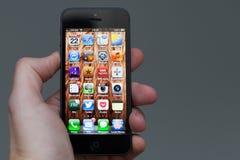 5在手中被暂挂的IPhone 免版税库存照片
