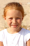 5女孩头发的恶作剧纵向红色年 免版税库存照片