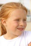 5女孩头发的恶作剧纵向红色年 免版税库存图片