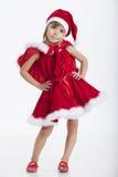 5逗人喜爱的女孩一点错过老圣诞老人& 库存图片