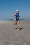 5 & 10 mile Winter Beach Run. JACKSONVILLE BEACH, FLORIDA - FEBRUARY 14: Runner Petri Helminen, age 45 of Jacksonville, Florida, finishes in second place in the royalty free stock photo