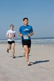 5 & 10 mile Winter Beach Run. JACKSONVILLE BEACH, FLORIDA - FEBRUARY 14: Runners compete in the 5 and 10 mile John Tenbroeck Memorial Winter Beach Run on stock photos