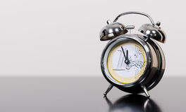 5 before 12 for the euro. Alarm clock as euro symbol at high time stock images
