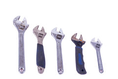 5 Adjustable spanners. Five multi use adjustable spanners that have been well used Stock Photo