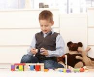 5 ans avec des jouets Photo stock