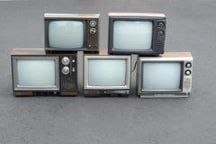 5 aparelhos de televisão do vintage Imagens de Stock Royalty Free