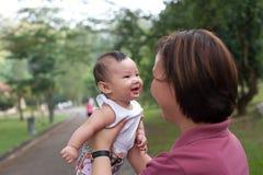 5 behandla som ett barn kinesiska den gammala flickamånaden Royaltyfri Foto