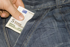 5 Euros and 5 Dollars. Euros and Dollars in jeans pocket Royalty Free Stock Photo