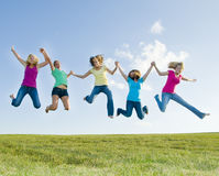 5 girls jumping in the air Stock Image