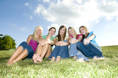 5 Girls sitting together and laughing Royalty Free Stock Photos