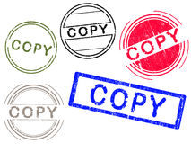 5 Grunge effect Office Stamps - COPY. 5 Grunge effect Office Stamp with the word COPY in a grunge splattered text. (Letters have been uniquely designed and Royalty Free Stock Photo