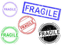 5 Grunge Stamps - FRAGILE Stock Images