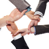 5 hands hold eachother on white background Royalty Free Stock Image