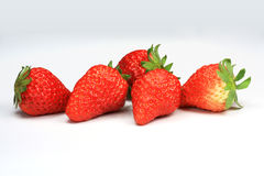 5 jordgubbar arkivfoto