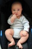 5 Monate alte Baby in einem Sitz Stockbild