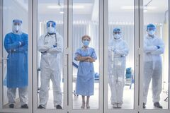 Free 5 Of Dortor, Nurse And Patient Looking Out In The Quarantine Room - Covid 19 Concept Stock Photography - 181535842
