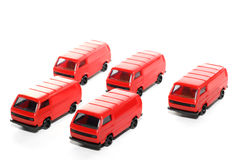 5 Plastic VW Van toy car. Picture of 5 small red German VW Vans. Plastic toys from my brothers toy collection. Isolated on real white Stock Photography