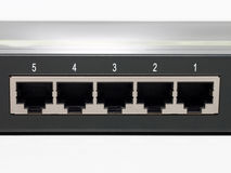 5 port switch closeup on plugs Royalty Free Stock Image