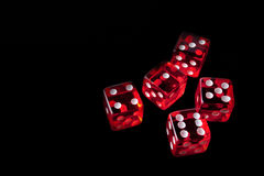 5 red dice in a corner Stock Photos