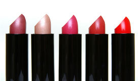 5 In A Row. Five lipsticks Royalty Free Stock Images