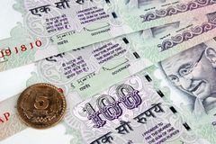 5 rupee Money coin on 100 rupee notes Stock Photography