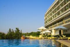 5 Star Hotel Pool. Luxury hotel poolside, blue sky Royalty Free Stock Photos