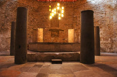 5 stone sentinels in the crypt. Eery atmosphere in the crypt. 5 stone pillars around the altar Royalty Free Stock Image