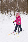 5 years old girl cross-country skiing Stock Image