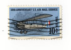 50 anniversary US air mail service stamp. A 10 cents stamp celebrating the 50th anniversary of the US air mail service Royalty Free Stock Photo