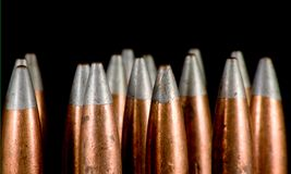 .50 BMG bullets on black Stock Images