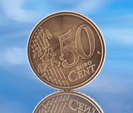 50 cents. Coin 50 euro cents, reflected in the base stock photography