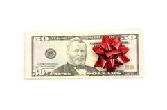 50 Dollar mit Feiertagsbogen Lizenzfreies Stockfoto