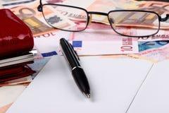 50 EURO. Fifty euro, notebook, money pen Stock Photo