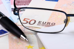 50 EURO. Money, pen, notebook and glasses Stock Image