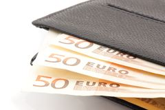 50 euro banknotes in leather wallet. Detail of 50 euro banknotes in leather wallet on white background Stock Image