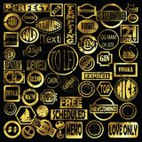 50 golden stamps. Editable stamps collection in gold against black background Stock Images