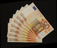 50 notas euro sobre negro   Fotos de archivo