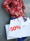 50 percent off. Young woman and the shopping bags respresenting 50 percent sale Royalty Free Stock Images