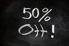 50 percent off. Promotion sale of 50 percent off written on blackboard Stock Photography