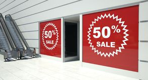 50 percent sale on shopfront windows and escalator Stock Image