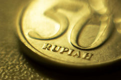 50 rupiah. A macro shot of 50 rupiah coin Royalty Free Stock Image