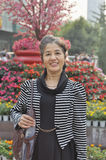 50's chinese woman at park Royalty Free Stock Photo
