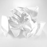 50 Shades of White. White paper rose on white background in varying shades of white Stock Photo