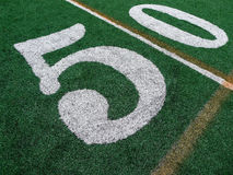 50 Yard Line. A close up of the fifty yard line mark on an AstroTurf football field Stock Photos