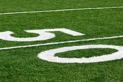 50 Yard line. At a Football Field, Artificial Turf Stock Photo