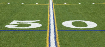 50 yard line on a football field Stock Photo