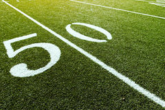 50 Yard Line on Football Field. Empty Football Field showing 50 Yard Line royalty free stock photos