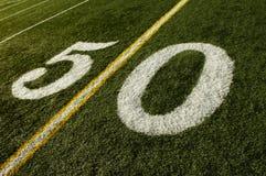 50 Yard Line Football Field. Photo of a American Football field 50 yard line stock image