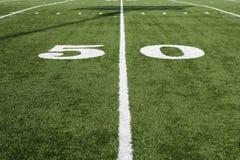 50 Yard Line On Green Field. 50 yard line on American football field Royalty Free Stock Photos