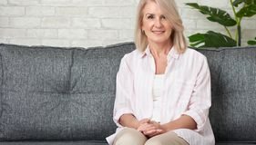 Free 50-year-old Woman Relaxing In Sofa Royalty Free Stock Photos - 158340608